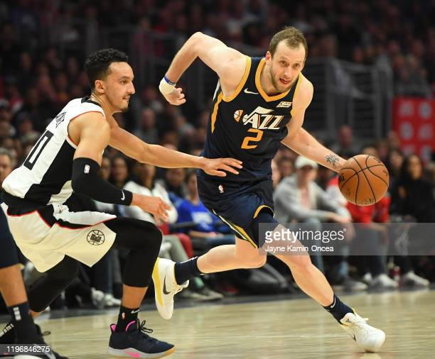 Landry Shamet of the Los Angeles Clippers guards Joe Ingles of the Utah Jazz as he drives to the basket in the game at Staples Center on December 28,...