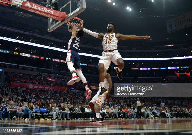 Landry Shamet of the Los Angeles Clippers scores a basket against David Nwaba of the Cleveland Cavaliers during the first half at Staples Center on...