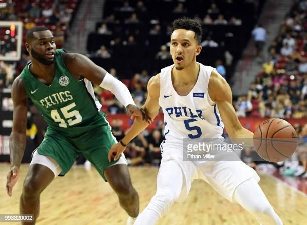 Landry Shamet of the Philadelphia 76ers passes under pressure from Kadeem Allen of the Boston Celtics during the 2018 NBA Summer League at the Thomas...
