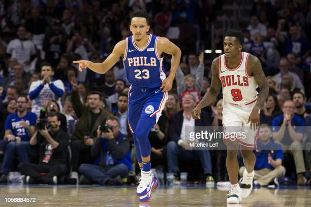 Landry Shamet of the Philadelphia 76ers reacts in front of Antonio Blakeney of the Chicago Bulls at the Wells Fargo Center on October 18 2018 in...