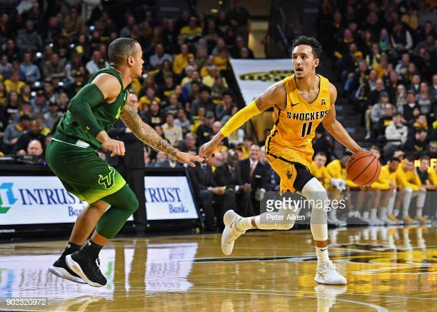 Landry Shamet of the Wichita State Shockers brings the ball up court against the South Florida Bulls during the first half on January 7 2018 at...