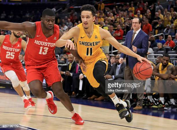 Landry Shamet of the Wichita State Shockers drives to the basket during a semifinal game of the 2018 AAC Basketball Championship against the Houston...