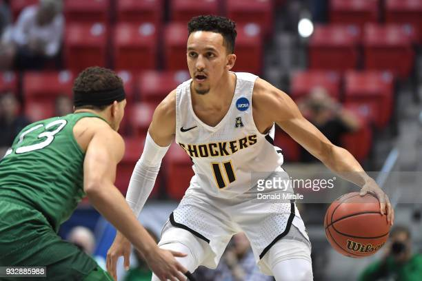 Landry Shamet of the Wichita State Shockers handles the ball against Jarrod West of the Marshall Thundering Herd in the first half during the first...