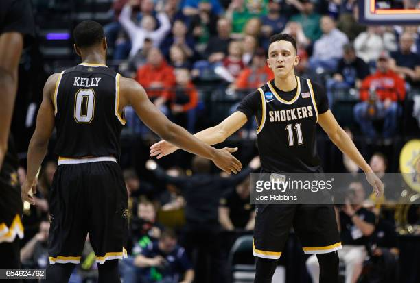 Landry Shamet of the Wichita State Shockers high fives Rashard Kelly in the first half against the Dayton Flyers during the first round of the 2017...