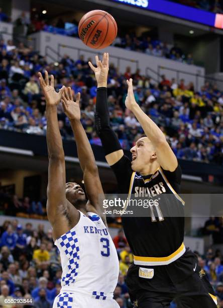Landry Shamet of the Wichita State Shockers shoots against Edrice Adebayo of the Kentucky Wildcats in the second half during the second round of the...