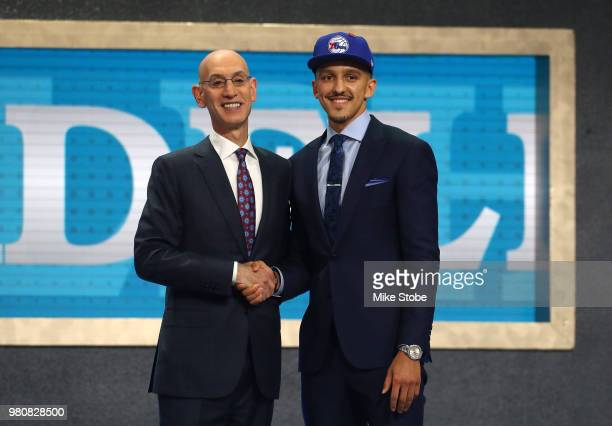 Landry Shamet poses with NBA Commissioner Adam Silver after being drafted 26th overall by the Philadelphia 76ers during the 2018 NBA Draft at the...