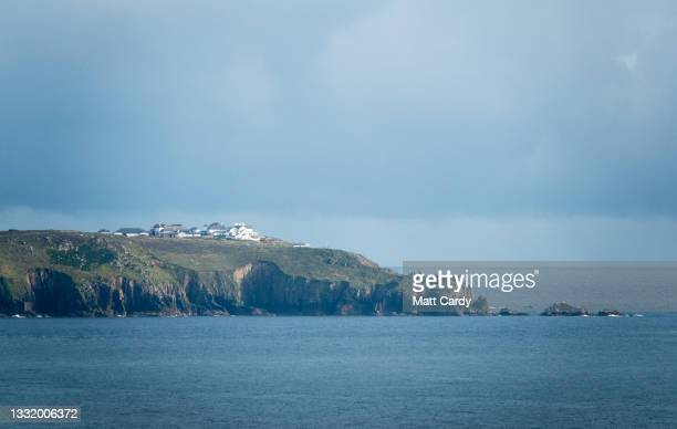 Lands End is viewed from Cape Cornwall on August 1, 2021 in Cornwall, England. With international travel restrictions remaining likely for this...