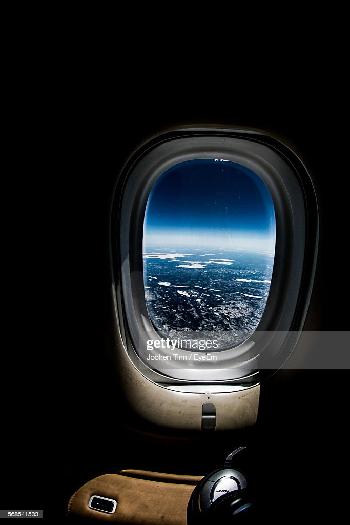 Landscape Against Blue Sky Seen Through Airplane Window : Stock Photo