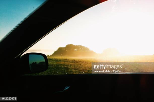 Landscape Against Clear Sky Seen Through Car Window During Sunset