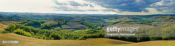 landscape along the road to monte oliveto maggiore abbey - abbey road stock pictures, royalty-free photos & images