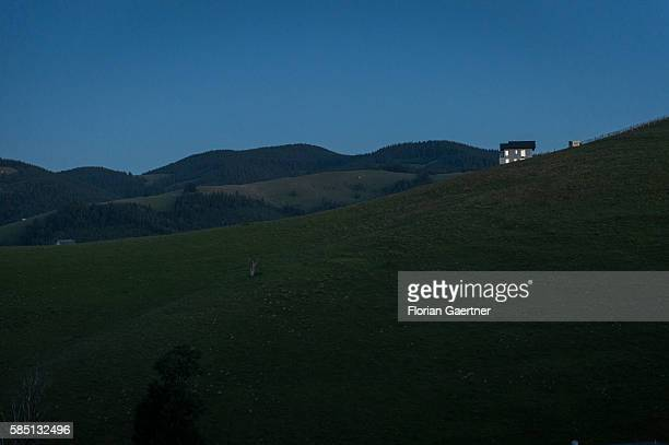 Landscape and a lone house are captured during blue hour on July 11, 2016 in Sibiu, Romania.