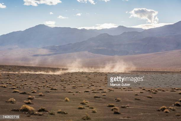 Landscape and dust storm at Ubehebe Crater in Death Valley National Park, California, USA