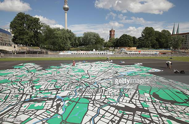 Landscape architect Lisa Hankow paints a giant map of Berlin in the city center the broadcast tower at Alexanderplatz and City Hall on August 6 2012...