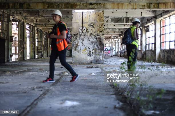 Landscape architects visit the old Rodhiaceta industrial site on July 4 2017 in Besancon eastern France The city of Besancon on July 4 launched the...