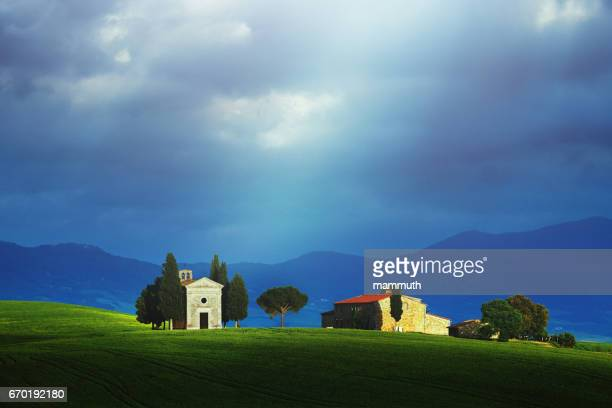 landscape at sunrise in tuscany (with the famous cappella di vitaleta) - italian cypress stock photos and pictures