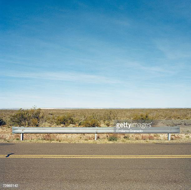 Landscape behind two lane highway