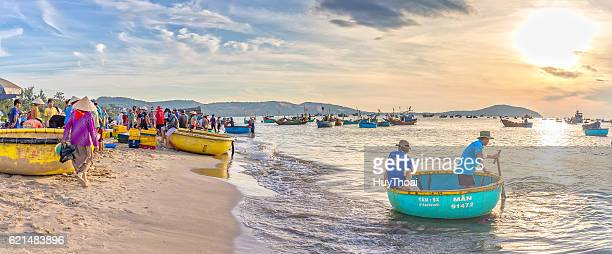 landscape brisk trade in fish at mui ne fishing village - fishing village stock pictures, royalty-free photos & images