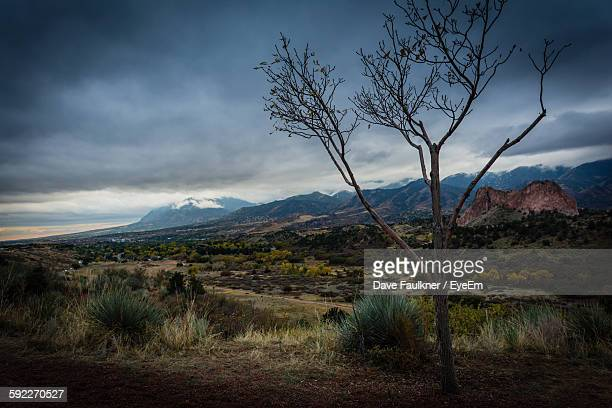 landscape by mountains against cloudy sky - dave faulkner eye em stock pictures, royalty-free photos & images