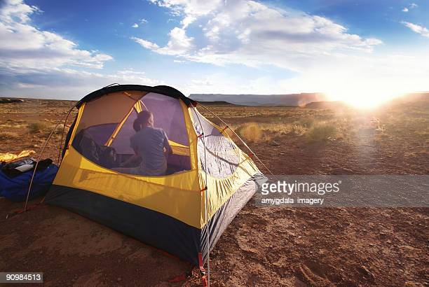landscape camping sunset woman in tent