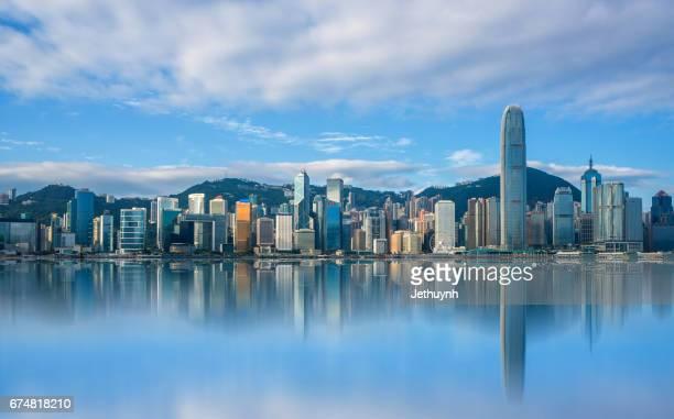 landscape city view of victoria harbour in hong kong with reflection - victoria harbour hong kong stockfoto's en -beelden