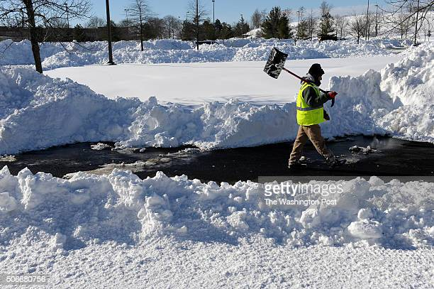 A landscape contractor works to clear the Monocacy MARC Train commuter parking lot after the blizzard January 24 2016 in Frederick MD