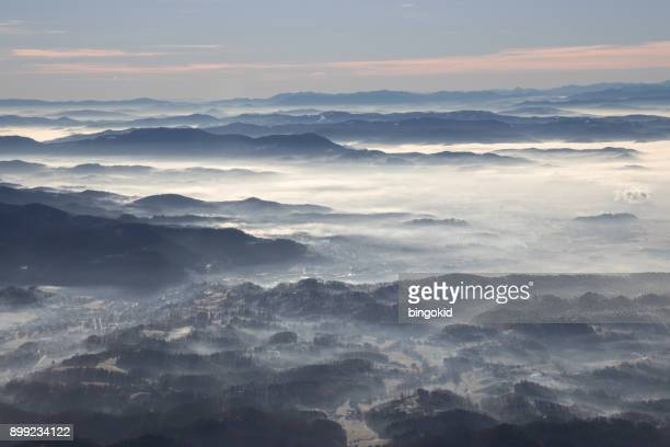 landscape covered in thin fog and mist - kranj stock pictures, royalty-free photos & images