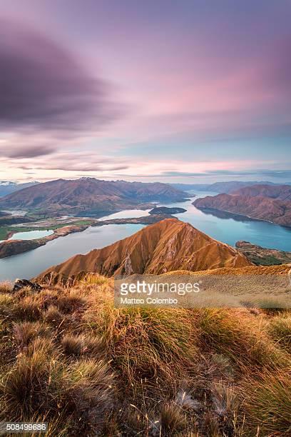landscape: epic sunset from mt roy, lake wanaka, new zealand - international landmark stock pictures, royalty-free photos & images