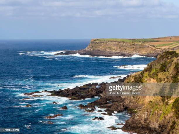 Landscape from a lookout, on the volcanic rocks of the coast or cliffs in Terceira Island in the Azores islands, Portugal.