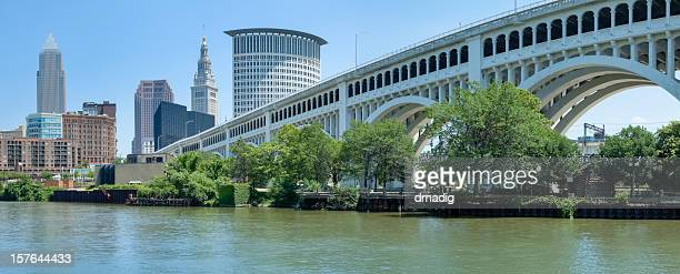 landscape image of cleveland skyline and bridge - cleveland ohio stock photos and pictures