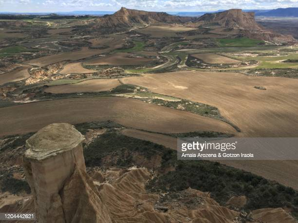 landscape in bardenas reales, navarre - pinnacle peak stock pictures, royalty-free photos & images