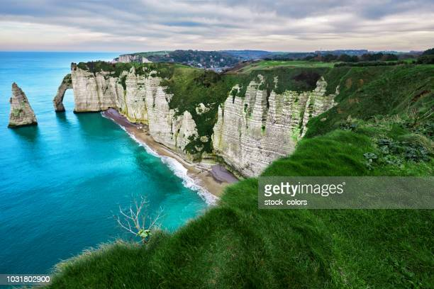 landscape in etretat - rocky coastline stock pictures, royalty-free photos & images