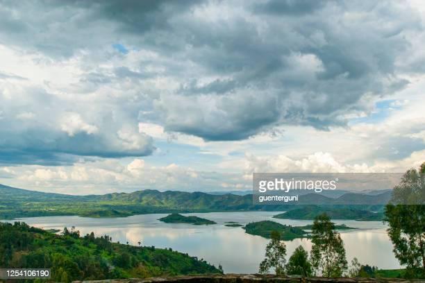 landscape in the lake region of rwanda - rwanda stock pictures, royalty-free photos & images