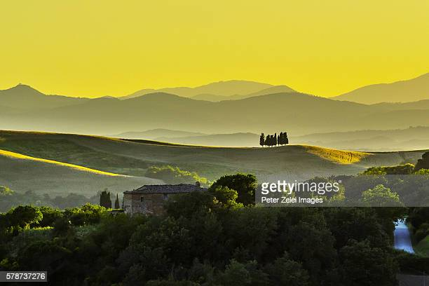 landscape in tuscany at sunset - italian cypress stock photos and pictures