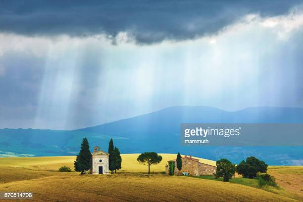 landscape in tuscany with the capella di vitaleta - italian cypress stock photos and pictures