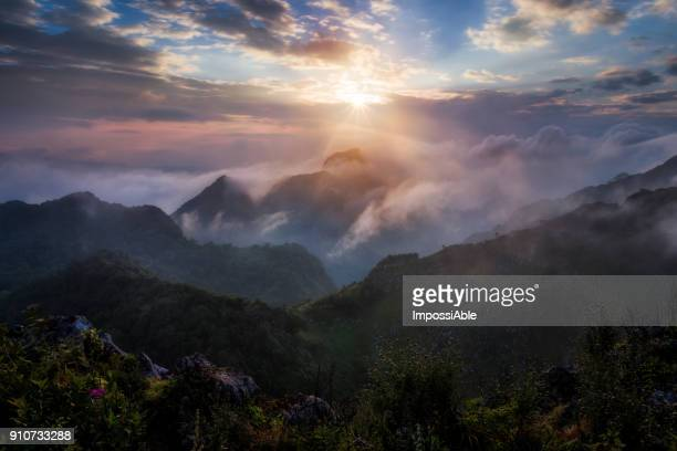 landscape mountain peak with cloud at sunset, chiangdao, chaingmai, thailand - impossiable stock pictures, royalty-free photos & images