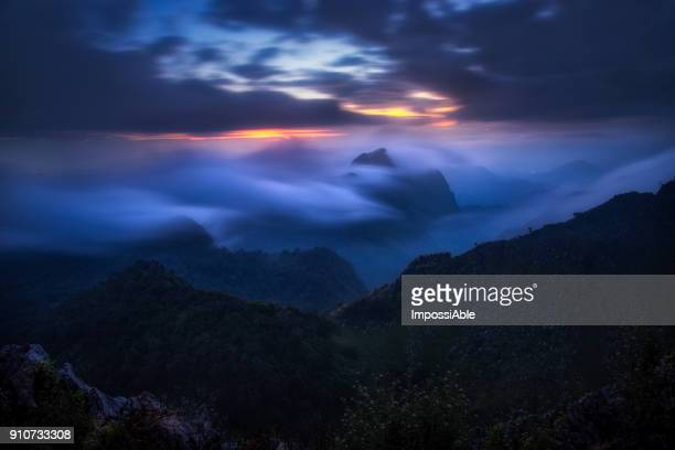 landscape mountain peak with fog blow through at sunset, chiangdao, chaingmai, thailand - impossiable stock pictures, royalty-free photos & images