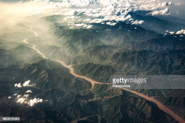 landscape mountain range and river aerial view from the airplane windows, china - impossiable stock pictures, royalty-free photos & images