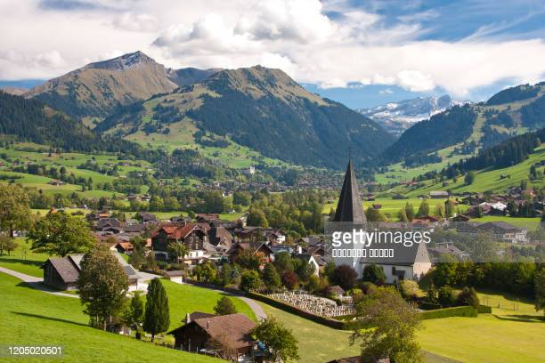 landscape near gstaad, summer view to saanen church and village - gstaad stock pictures, royalty-free photos & images