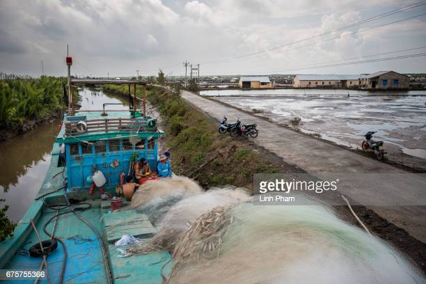 Landscape of a briny water canal next to a shrimp farm on April 29 2017 in Tan Thuy Village Ba Tri District Ben Tre Province Vietnam He said the...