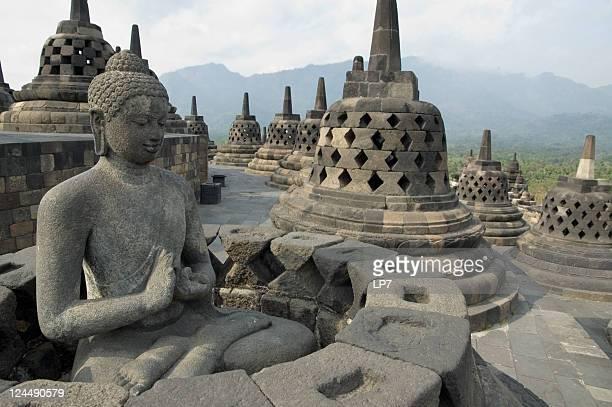 Landscape of a Buddha statue at Borobudur in Java, Indonesia
