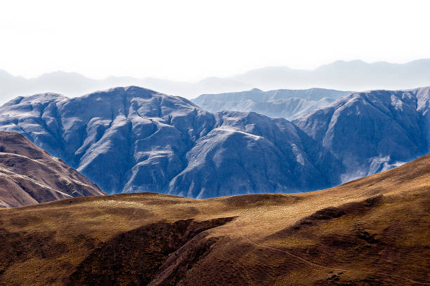 Landscape Of Bare And Arid Mountains Layer After Layer That Change Color And Texture In The Distance
