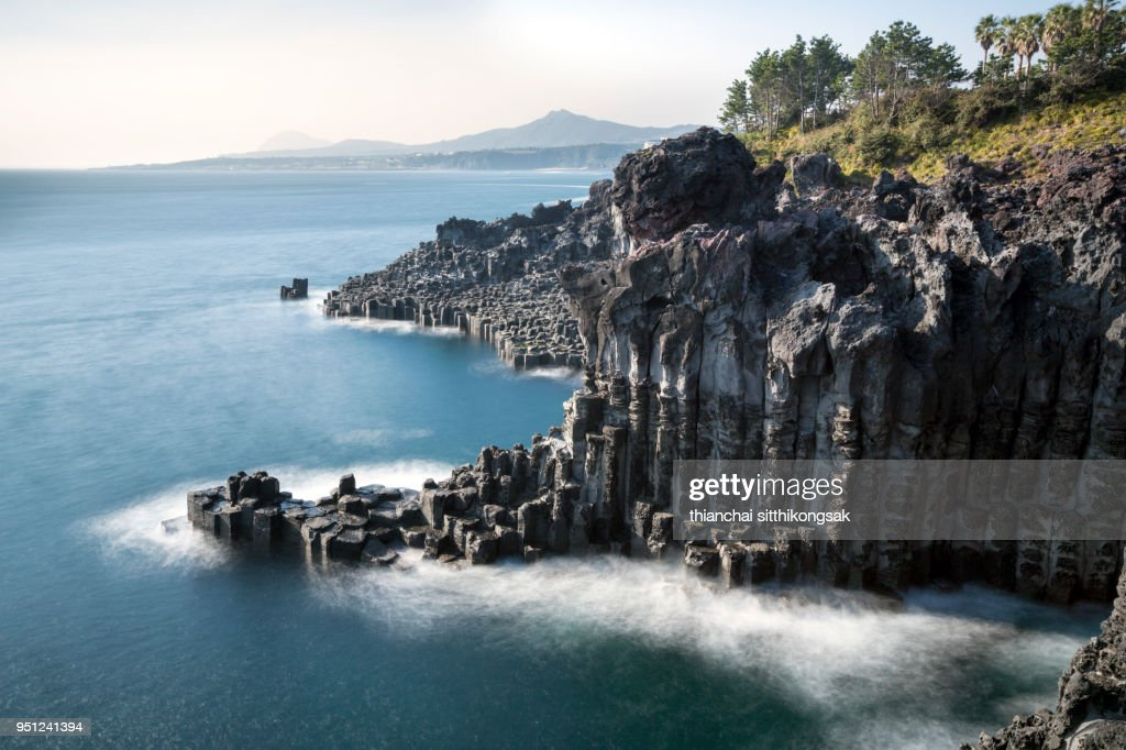 landscape of cliff and white of wave at jeju island : Stock Photo