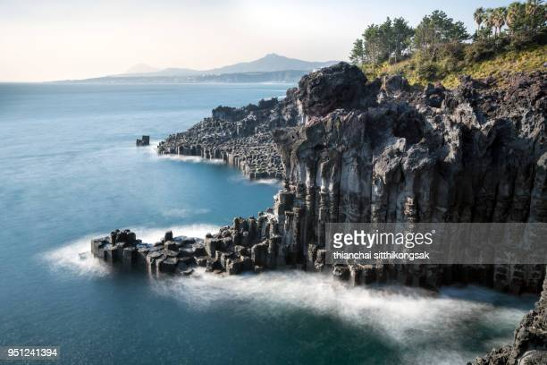 landscape of cliff and white of wave at jeju island - south korea stock pictures, royalty-free photos & images