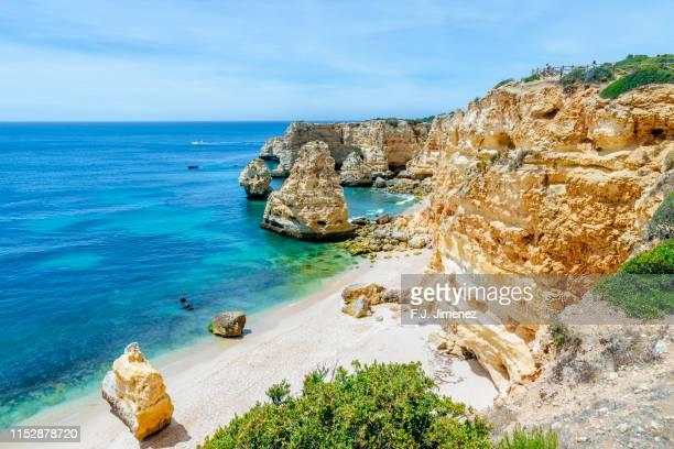 landscape of cliffs at marinha beach in the algarve, portugal - アルガルヴェ ストックフォトと画像