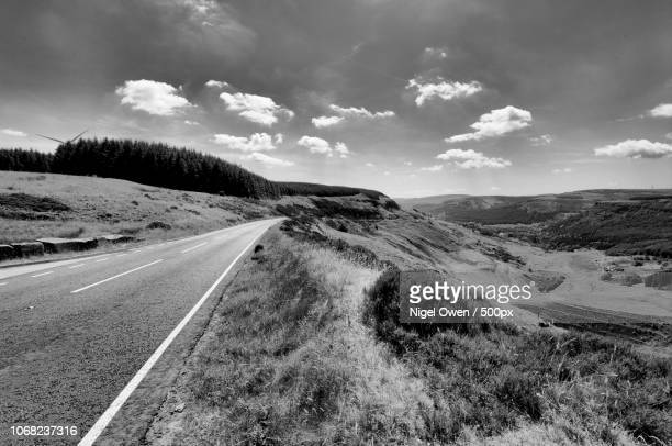 landscape of country road - nigel owen stock pictures, royalty-free photos & images