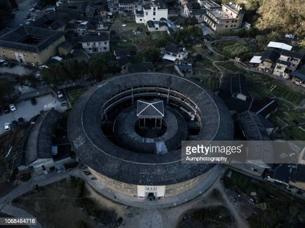 landscape of fujian tulou, china. - fujian stock photos and pictures