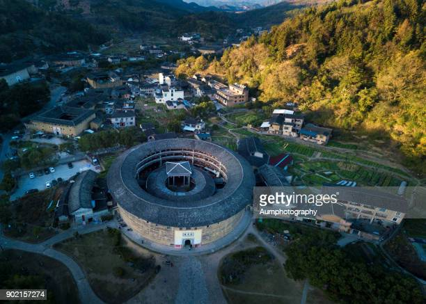 landscape of fujian tulou, china. - fujian tulou stock pictures, royalty-free photos & images