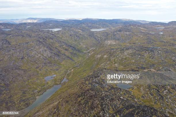 Landscape of Greenland from above A typical view of the Greenlandic landscape photographed a couple of hundred meters above the ground The land is...