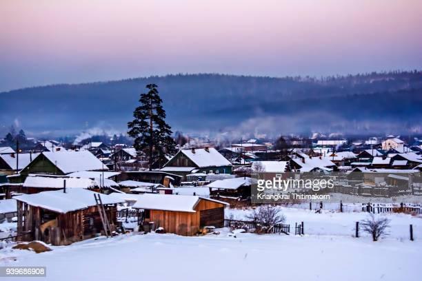 landscape of houses in siberia, russia - シベリア ストックフォトと画像