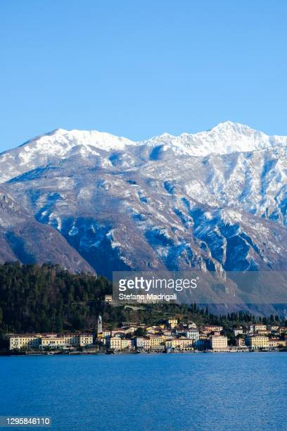 landscape of lake como with menaggio and snow-capped mountains - stresa stockfoto's en -beelden